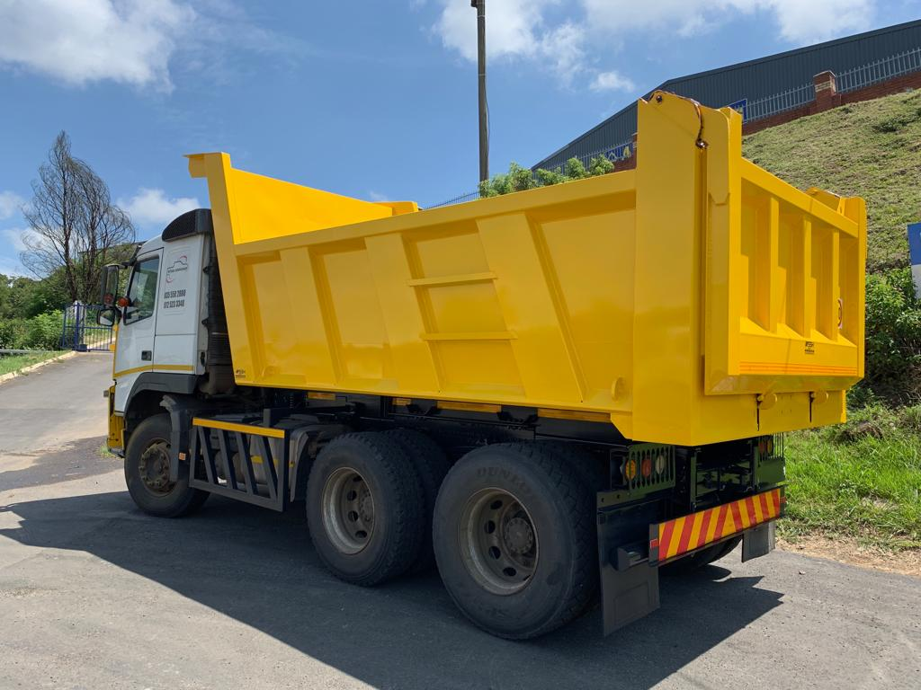 yellow tippers truck built by ssh bodies